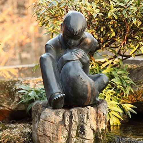 Statue de garçon et de chien basée sur la sculpture de Sylvia Shaw Judson